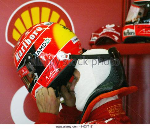 FERARRI FORMULA ONE DRIVER SCHUMACHER WEARS HIS HELMET WITH THE HANS SAFETY DEVICE DURING TIMED SESSION IN SEPANG.